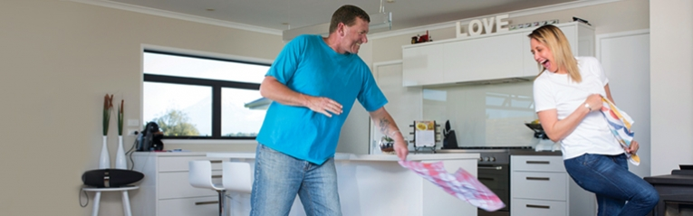 Couple having tea towel fight